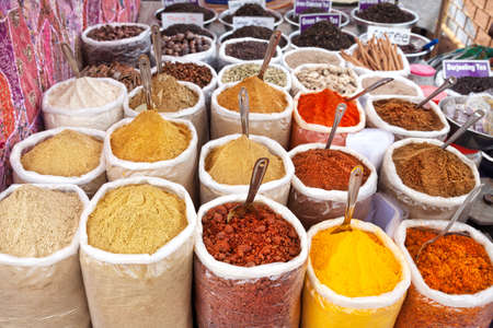 Various of Indian colored powder spices at Anjuna flea market in Goa, India photo