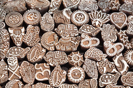 Various of different henna wooden stamps at Anjuna flea market in Goa, India