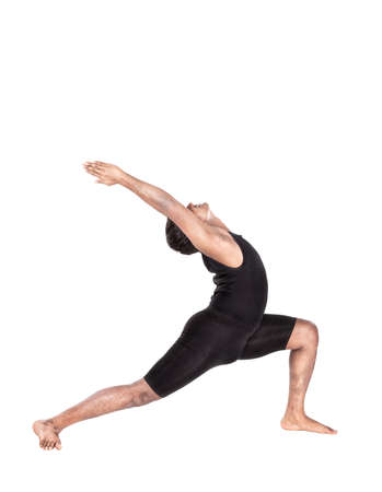 Yoga virabhadrasana warrior pose by Indian man in black costume isolated at white background. Free space for text photo