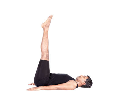 Yoga uttanpadasana pose by Indian man in black costume isolated at white background  Free space for text photo