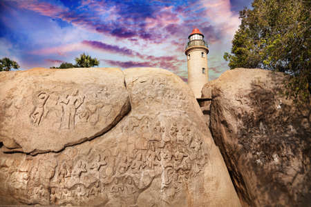 mamallapuram: Ancient basrelief and lighthouse at purple sky in Mamallapuram, Tamil Nadu, India