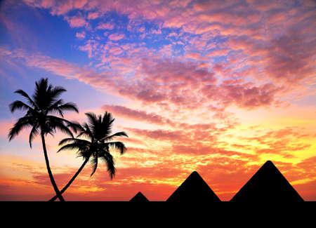 tumbas: Pir�mides egipcias y palmeras en silueta en naranja el cielo
