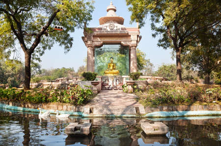 new delhi: Golden Buddha statue and pond with gooses in Buddha Jayanti park, New Delhi, India Stock Photo