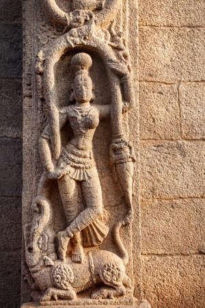 Hindu goddess on the wall in Mamallapuram, Tamil Nadu, India photo