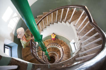 kovalam: Woman standing on Spiral stairs inside of lighthouse in Kovalam, Kerala, India