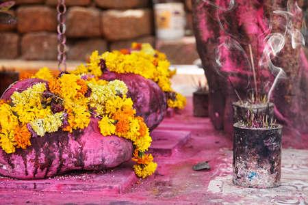 rituals: Saffron flower garlands and incense near Arambol temple, Goa, India