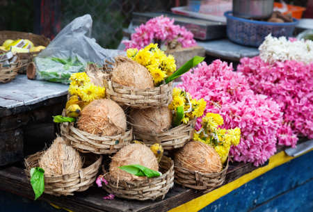Flowers and coconuts in baskets near Kapaleeshwarar temple in Chennai, Tamil Nadu, India