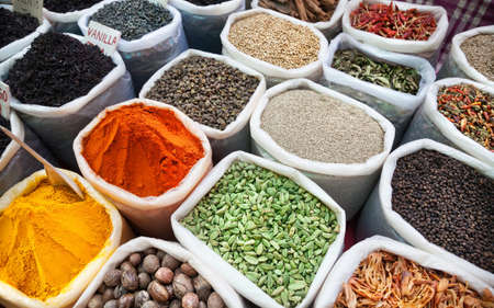 india people: Indian colorful spices and tea at Anjuna flea market in Goa, India