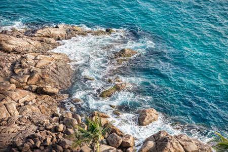kovalam: Blue sea and rocks on Lighthouse beach in Kovalam, Kerala, India