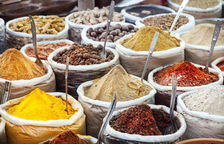 Indian colorful spices and tea at Anjuna flea market in Goa, India
