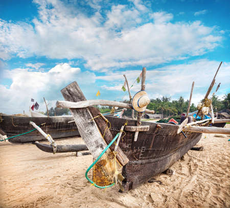 india fisherman: Fisherman boats on the Gokarna beach in Karnataka, India   Stock Photo