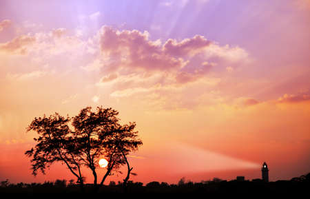mamallapuram: Lighthouse silhouette with ray at sunset sky in Mamallapuram, Tamil Nadu, India