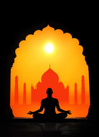 Man silhouette doing meditation at Taj Mahal background in India photo