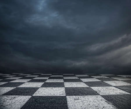 wonderland: Chess floor and dramatic overcast sky premade background Stock Photo