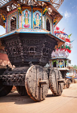 chariot: Wooden chariots with flags and paintings of hindu gods in Gokarna city, Karnataka, India