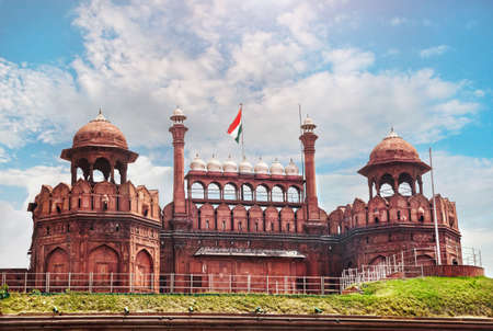 Lahore Gate of Red Fort with Indian national flag at blue sky in Old Delhi, India photo
