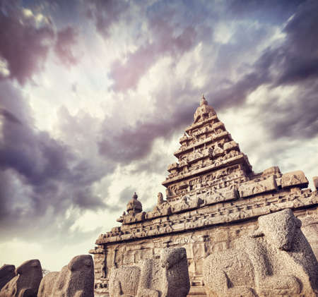 mamallapuram: Shore temple with bull statues at blue dramatic sky in Mamallapuram, Tamil Nadu, India