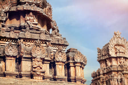 deities: Ancient Hindu temple with deities and mythological creatures at blue sky in Hampi, Karnataka, India