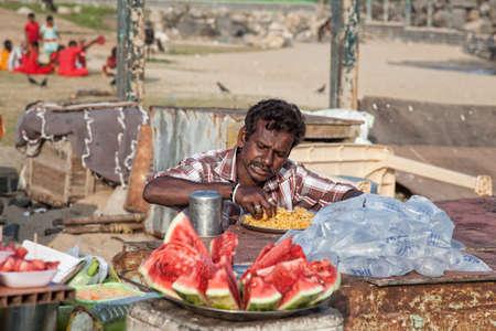 mamallapuram: Mamallapuram, Tamil Nadu, INDIA - January 23  Indian man eating traditional rice with his hands on Mamallapuram beach on January 23, 2013
