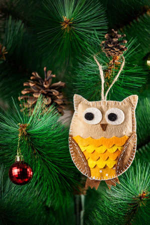 made by hand: Handmade owl from felt on Christmas tree with cones