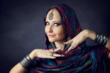 bollywood woman: Portrait of beautiful woman wrapped in scarf