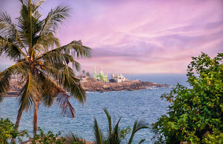 kovalam: View to the green Mosque near the ocean in Kovalam, Kerala, India Stock Photo