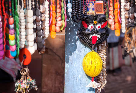Devil black face amulet, jewelries and souvenirs in Gokarna citry market, Karnataka, India    photo