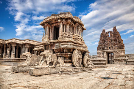 Stone chariot in courtyard of Vittala Temple at blue sky in Hampi, Karnataka, India