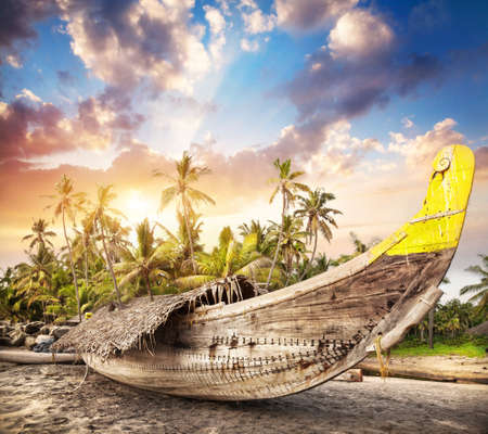 india fisherman: Fisherman boat on the beach at sunset sky in India   Stock Photo