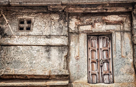 ancient prison: Wooden locked door in old house in Hampi, Karnataka, India
