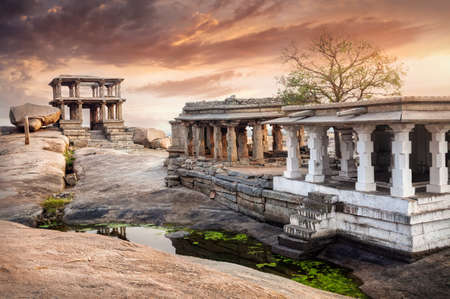 civilizations: Ancient ruins of Vijayanagara Empire at sunset sky in Hampi, Karnataka, India