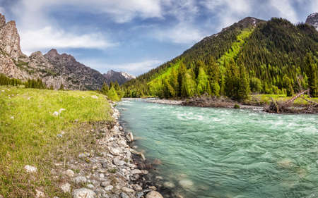 Mountain river in the valley with green trees in Dzungarian Alatau, Kazakhstan, Central Asia photo