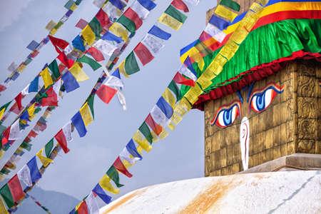 kathmandu: Buddha eyes close up with prayer flags at Bodhnath stupa in Kathmandu valley, Nepal