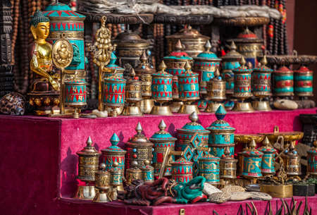 bodnath: Prayer wheels from turquoise stone and other souvenirs in the shop near Bodnath stupa, Kathmandu valley, Nepal    Stock Photo