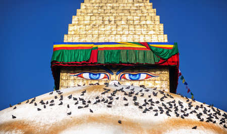 Buddha eyes close up on golden tower at Bodhnath stupa in Kathmandu valley, Nepal