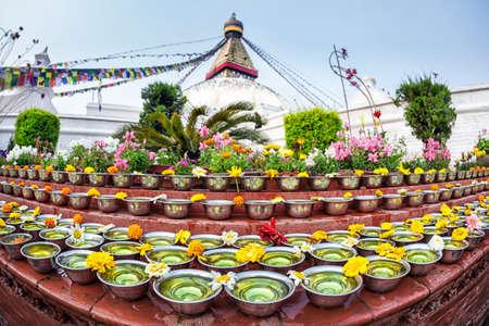 Bowls with saffron water at Bodhnath stupa in Kathmandu valley, Nepal photo