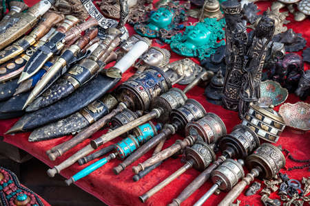 Prayer wheels, Nepali knives and other souvenirs in the shop at Durbar square in Kathmandu, Nepal    photo