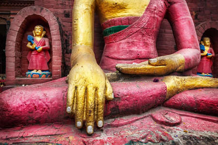 the stupa: Buddha statue at Swayambhunath stupa in Kathmandu, Nepal    Stock Photo