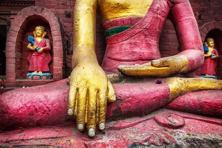 stupas: Buddha statue at Swayambhunath stupa in Kathmandu, Nepal    Stock Photo