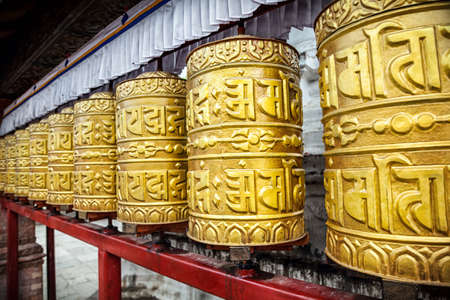 Golden prayer wheels at Swayambhunath stupa in Kathmandu, Nepal    photo
