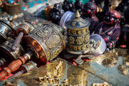Prayer wheels and other souvenirs in the shop at Durbar square in Kathmandu, Nepal    photo