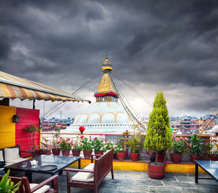 bodnath: Rooftop restaurant with Bodnath stupa view in Kathmandu valley, Nepal Stock Photo