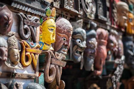 kathmandu: Souvenir masks with Hindu deities on the wall in the shop of Bhaktapur, Kathmandu valley, Nepal
