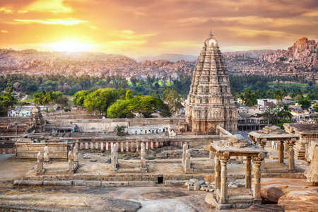 Virupaksha temple view from Hemakuta hill at sunset in Hampi, Karnataka, India Stock Photo