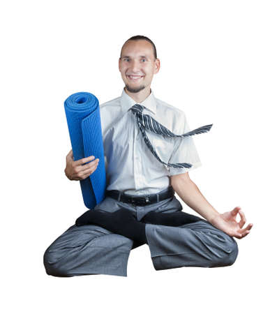 Businessman holding yoga mat and doing Levitation in lotus pose isolated on white background photo