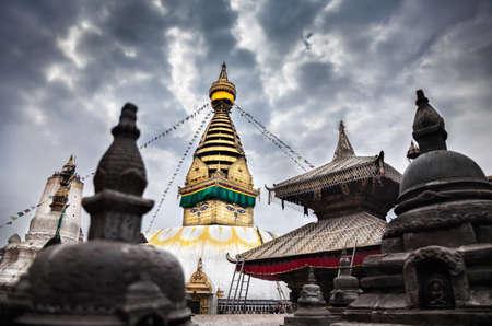 Swayambhunath stupa at overcast cloudy sky in Kathmandu, Nepal