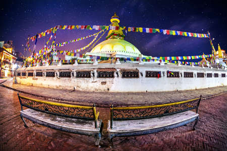 Bodhnath stupa at night sky with stars in Kathmandu valley, Nepal photo