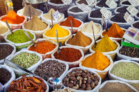 coriander seeds: Indian colorful spices at Anjuna flea market in Goa, India Stock Photo
