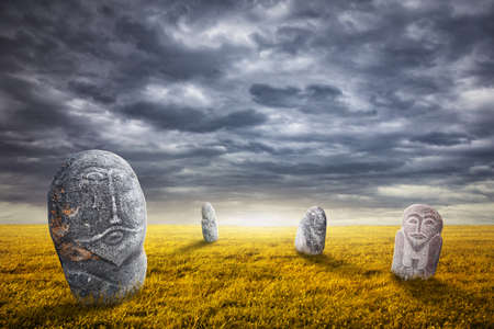 kazakhstan: Ancient balbal statues on the field at overcast sky in central Asia