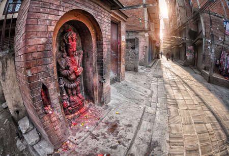 stone carving: Small Hindu temple with statue of Indra godess at the street in the morning